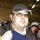 A man believed to be Kim Jong Nam is pictured in February 2007 at Beijing airport, as Malaysia said it will carry out a second post-mortem (Kyodo News via AP, File)