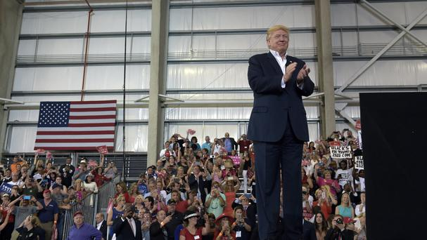 President Donald Trump waits to speak at his rally in Melbourne, Florida (AP Photo/Susan Walsh)