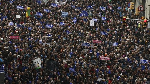 Thousands of people marched to demand Spain's government increase its efforts to take in refugees (AP)