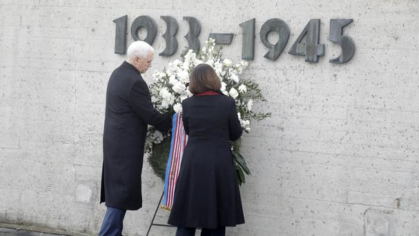 US Vice President Mike Pence and his wife Karen lay a wreath in Dachau