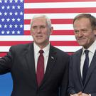 Mike Pence, left, with Donald Tusk (AP/Thierry Monasse)