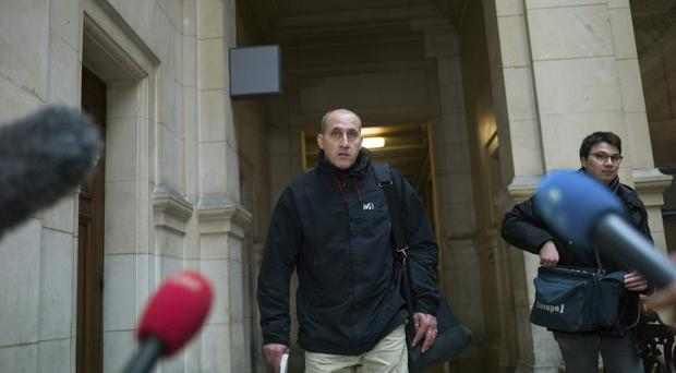 Vjeran Tomic arrives at court in Paris (AP/Thibault Camus)