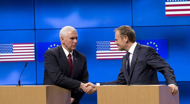 US Vice President Mike Pence shakes hands with European Council president Donald Tusk in Brussels (Virginia Mayo/AP)