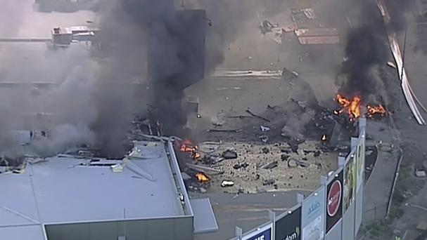 The plane crashed into the rear of the shopping centre (Channel 9/AP)
