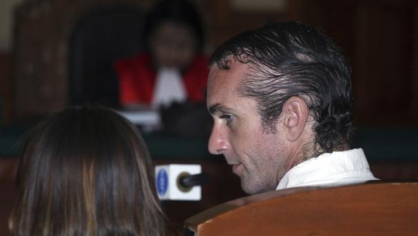 David Taylor listens to an Indonesian interpreter during his trial in Bali (AP)