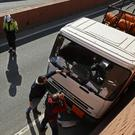 Police inspect a truck after a man was arrested in Barcelona (AP)