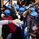 Riot police clash with taxi drivers during a demonstration, in Rome (Ansa/AP)