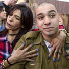 Israeli soldier Elor Azaria is embraced by his mother at his sentencing Photo: Jim Hollander AP