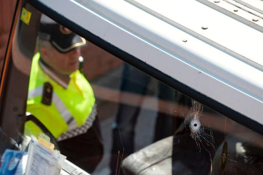 Bullet impacts can be seen on the truck's windscreen