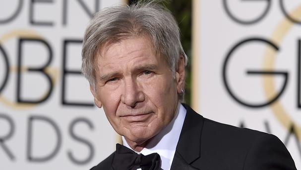 The plane piloted by Harrison Ford, pictured, mistakenly flew low over an airliner at John Wayne Airport (Invision/AP)