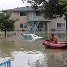 Rescuers travel by boat through a flooded neighbourhood in San Jose (AP/Marcio Jose Sanchez)