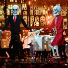 Katy Perry performing on stage with skeleton puppets dressed as Donald Trump and Theresa May at the Brit Awards at the O2 Arena, London, last night. Photo: Dominic Lipinski/PA