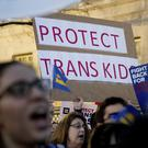 Members of the National Centre for Transgender Equality protest in front of the White House (AP)
