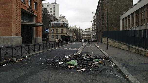 Debris in front of a school in Paris after a protest against alleged police abuses (AP/Thibault Camus)