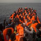African refugees and migrants wait for help aboard a boat off the Libyan coast (AP/Santi Palacios)