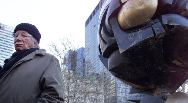 German artist Fritz Koenig stands next to his bronze sculpture The Sphere in New York (AP)