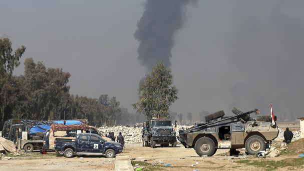 Smoke rises as Iraqi security forces deploy inside Mosul's international airport (AP/ Khalid Mohammed)
