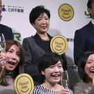 Tokyo governor Yuriko Koike with some office workers during a event to mark Premium Friday (AP/Koji Sasahara)