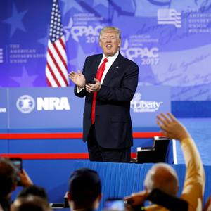US President Donald Trump applauds his supporters after speaking at the Conservative Political Action Conference, in Oxon Hill in Maryland yesterday. Photo: Reuters/Kevin Lamarque