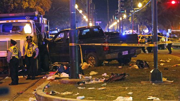The pick-up truck slammed into the crowd and other vehicles, causing multiple injuries (AP)
