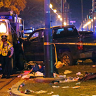 Police stand next to a truck that slammed into a crowd and other vehicles, causing multiple injuries Photo: AP/Gerald Herbert