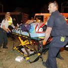 A victim is taken to hospital after the pick-up truck ploughed into a the Krewe of Endymion parade crowd (The Advocate/AP)