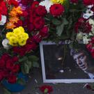 Flowers and a portrait of Russian opposition leader Boris Nemtsov lie at the place where he was gunned down, in Moscow. (AP/Ivan Sekretarev)