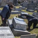 Philadelphia Police at Mount Carmel Cemetery. (Michael Bryant/The Philadelphia Inquirer/AP)