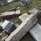 Damaged headstones at Mount Carmel Cemetery in Philadelphia (AP)