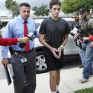 Austin Harrouff is transported by detectives to jail from St Mary's Hospital in Florida in 2016 (Richard Graulich/Palm Beach Post via AP)