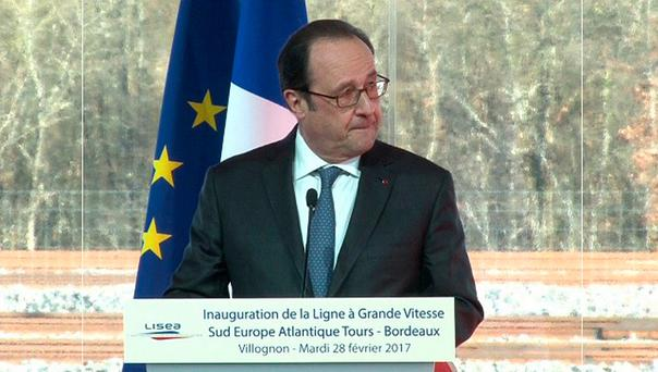 French President Francois Hollande, seen in this still image taken from video, reacts after a shot was fired by a police sharpshooter that accidentally wounded two people while he was giving a speech in Villognon, in the south-west of France