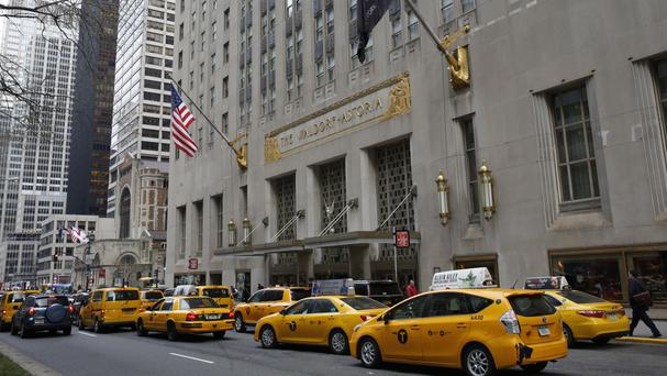 Taxis line up in front of the renowned Waldorf Astoria hotel in New York (Kathy Willens/AP)
