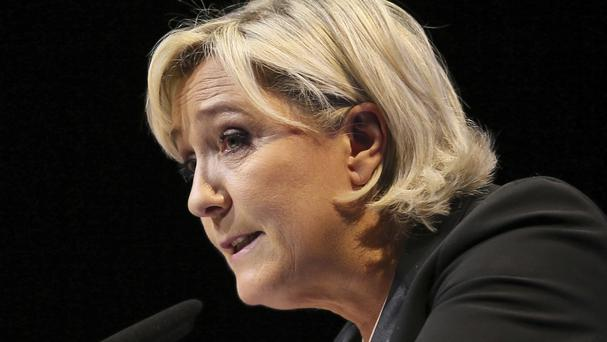 Marine Le Pen, in addition to being the leader of France's far-right National Front party, is also a politician in the European Parliament (David Vincent/AP)