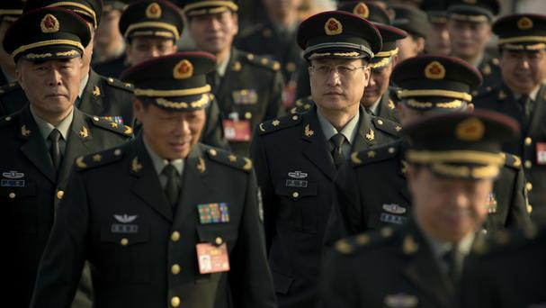 China is to raise military spending by 7% (AP/Mark Schiefelbein)