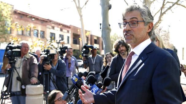 Attorney Robert Blume speaks to reporters outside federal court in Santa Ana, California (Nick Ut/AP)