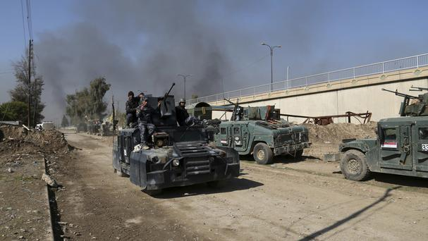 Iraqi security forces advance during fighting against Islamic State in western Mosul (Khalid Mohammed/AP)