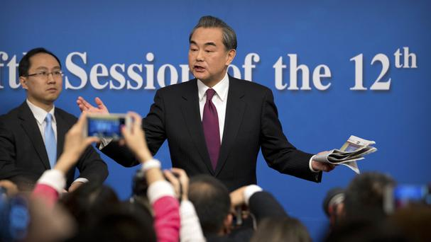 Chinese Foreign Minister Wang Yi addresses a press conference in Beijing (Mark Schiefelbein/AP)