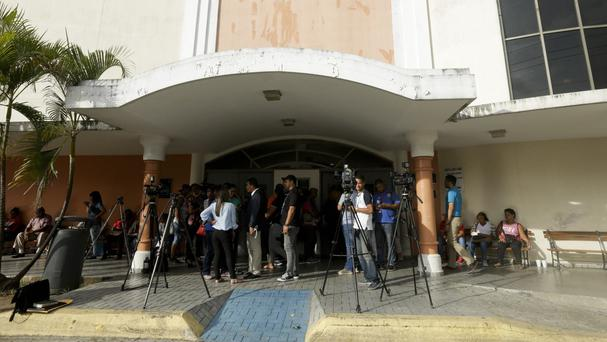 Journalists stand outside entrance of the Santo Tomas public hospital in Panama City. (AP/Arnulfo Franco)