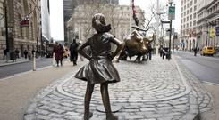 The Fearless Girl statue faces Wall Street's charging bull in New York (AP/Mark Lennihan)