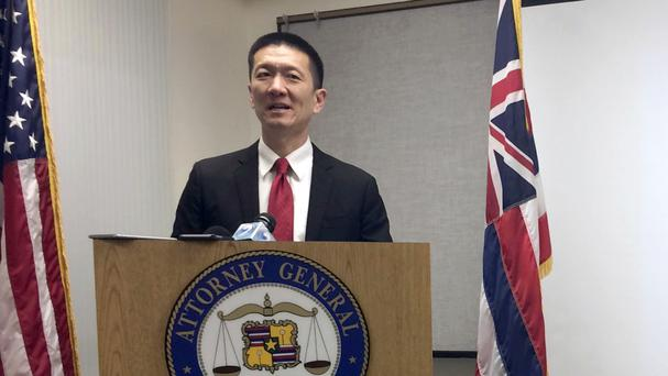 Hawaii attorney general Doug Chin speaks at a news conference in Honolulu announcing the state has filed a lawsuit over Donald Trump's travel ban (AP)