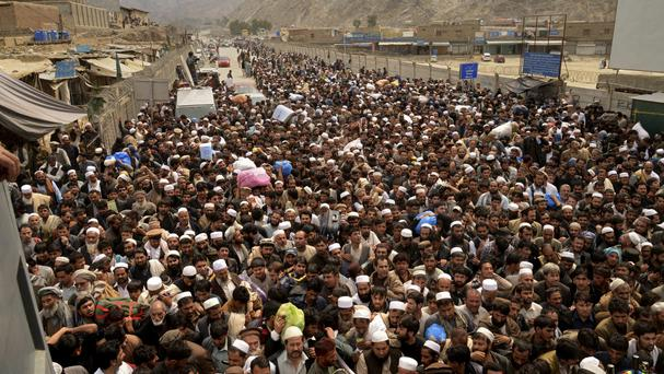 Afghan nationals prepare to cross the Torkham border post in Pakistan en route to Afghanistan (Muhammad Sajjad/AP)