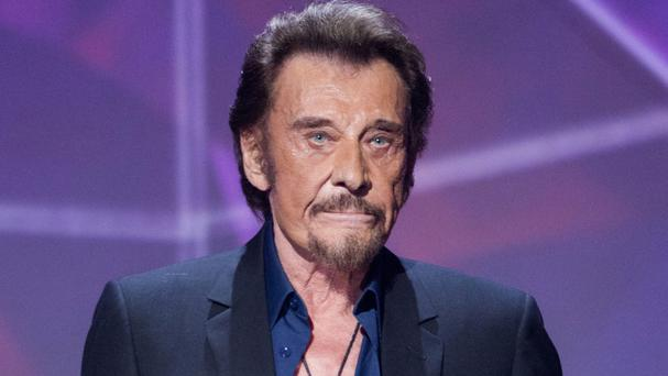 Johnny Hallyday says his condition is not life-threatening (Jacques Brinon/AP)