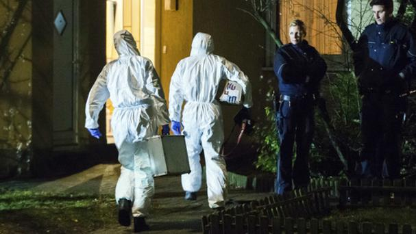 Forensic scientists at a house in Herne, Germany, after the death of a nine-year-old boy (Marcel Kusch/dpa via AP)