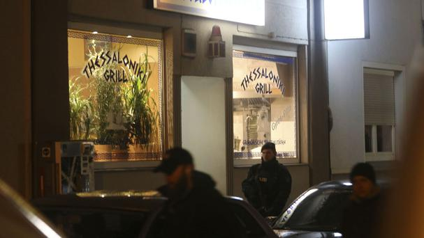 Police outside a Greek restaurant in Herne, Germany, where the suspect was arrested (Roland Weihrauch/dpa via AP)