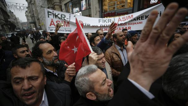 Supporters of Turkey's president Recep Tayyip Erdogan stage a protest outside the Dutch consulate in Istanbul (AP)