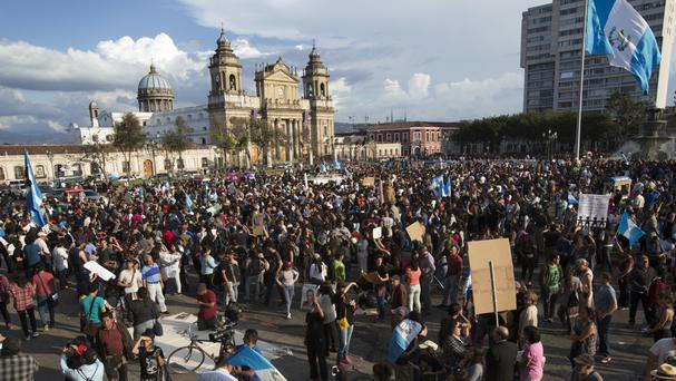 Protesters gather in front of the National Palace in Guatemala City (Moises Castillo/AP)