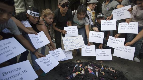 Protesters demonstrate in front of the National Palace in Guatemala City (AP)