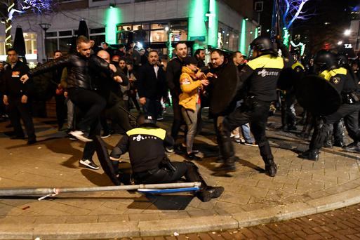 Riot police clash with demonstrators in the streets near the Turkish consulate in Rotterdam in the early hours of yesterday. Photo: Reuters/Dylan Martinez