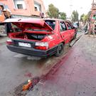 Blood stains the ground at the site of an attack by two suicide bombers in Damascus, Syria. Photo: Reuters/Omar Sanadiki