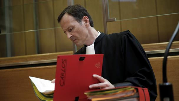 Carlos the Jackal's lawyer Francis Vuillemin reads files at a Paris court (AP)